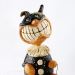 Lil' Cheesy Grin Trick or Treat Pumpkin by David Everett